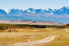 View of the snow-covered North-Chuya range and Kurai steppe in the Altai mountains, Siberia, Russia royalty free stock image