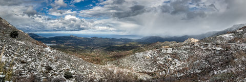 Panoramic view of snow on mountain village of Speloncato in Cors Royalty Free Stock Images