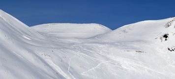 Panoramic view on snow off-piste slope with traces of skis, snow. Panoramic view on snowy slope for freeriding with traces of skis, snowboards and avalanches Stock Photography