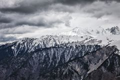 Panoramic view on snow winter mountains and cloud sky. Caucasus Mountains. Svaneti region of Georgia. Dramatic Panoramic view on snow winter mountains and Royalty Free Stock Photography