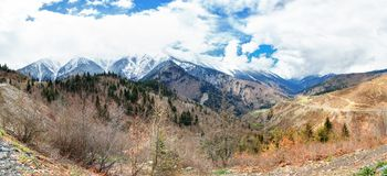 Panoramic view on snow winter mountains and cloud sky. Caucasus Mountains. Svaneti region of Georgia. Dramatic Panoramic view on snow winter mountains and Stock Photography