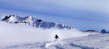 Panoramic view on snowboarder downhill on off-piste slope with n Royalty Free Stock Images