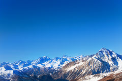 Panoramic view of snowcapped mountain at sunny day Royalty Free Stock Images