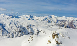 Panoramic view of snowy mountain range in winter Stock Images
