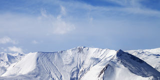 Panoramic view on snowy mountains with avalanches Stock Image