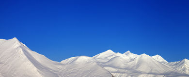 Panoramic view of snowy mountains and blue clear sky Royalty Free Stock Photography