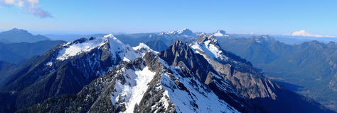 Panoramic View of Snowy Mountains. Royalty Free Stock Photo