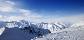 Panoramic view on snowy mountains at sun day Royalty Free Stock Image