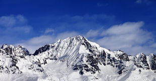 Panoramic view on snowy mountains at sun day Stock Photo