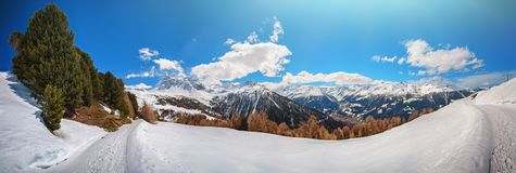 Panoramic view on snowy peaks of Alps mountains royalty free stock images
