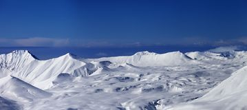 Panoramic view on snowy plateau and blue sky at nice day Stock Photo