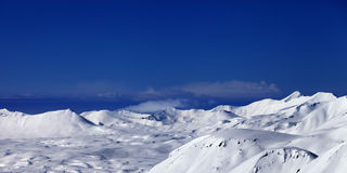 Panoramic view on snowy plateau at nice day Royalty Free Stock Photography