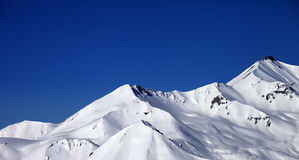 Panoramic view on snowy winter mountains and clear blue sky in s Stock Photo