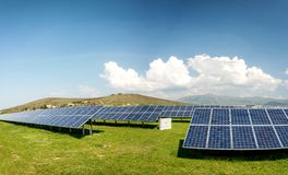 Panoramic view of solar panels, photovoltaics, alternative electricity source. Concept of sustainable resources royalty free stock photography