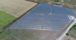 Panoramic view of a solar power plant, rows of solar panels, solar panels, top view, Aerial view to solar power plant stock video footage