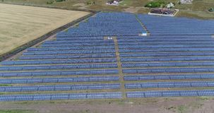 Panoramic view of a solar power plant, rows of solar panels, solar panels, Aerial view to solar power plant stock video footage