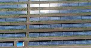 Panoramic view of a solar power plant, rows of solar panels, solar panels, top view, Aerial view to solar power plan stock footage