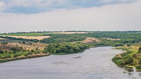 Panoramic view of the South Bug River. The river has stony granite banks. Ukraine. stock photos
