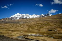Panoramic view of spectacular high mountains, Cordillera, Andes, Peru, Clear blue sky with a few white clouds. Scenic landscape, wallpaper, mountains covered stock photo