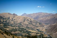Panoramic view of spectacular high mountains, Cordillera, Andes, Peru, Clear blue sky with a few white clouds. Scenic landscape, wallpaper royalty free stock photo