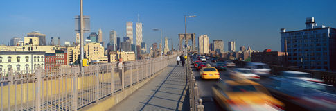 Panoramic view of speeding taxis driving over Brooklyn Bridge to Manhattan, New York City, NY Royalty Free Stock Images