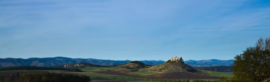 A northern panoramic view of Spis castle, Drevenik and Ostra hora in early spring. A panoramic view of Spis castle, Drevenik, Ostra hora, Slovak Ore Mountains in stock image