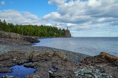 Panoramic view of the Split Rock Lighthouse from a nearby rocky beach royalty free stock photos
