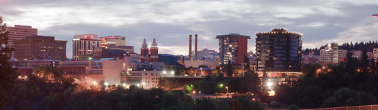 Panoramic View Spokane Washington Downtown City Skyline Sunrise. The sun rises behind historic Spokane Washington Stock Images