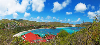 Panoramic view of St Jean beach, airport, eden, rock, St Barth, sailboats Stock Images