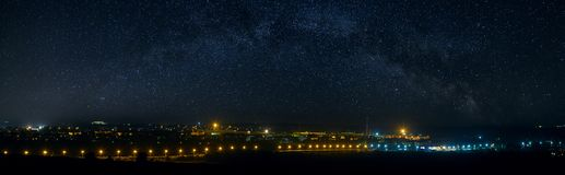 Panoramic view of the starry night sky above the city. Panoramic view of the starry night sky above the city Stock Images
