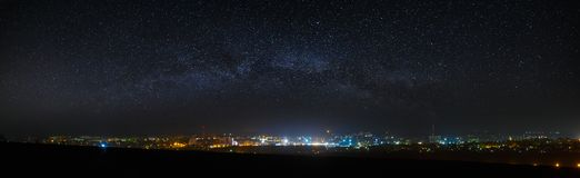 Panoramic view of the starry night sky above the city. Panoramic view of the starry night sky above the city Stock Photography