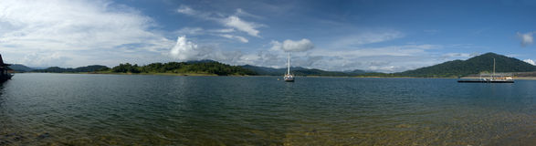 Panoramic view of a stationary yacht. On calm lake Royalty Free Stock Image