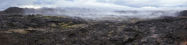 Steaming lava field panorama Krafla volcanic area Myvatn region Northeastern Iceland Scandinavia. Panoramic view of steaming lava field at Krafla volcanic area stock photos