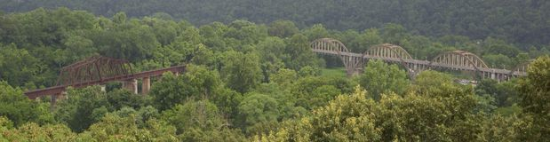 Panoramic View of Steel and Wood Overpass Bridges. Wide-angle view of one steel and one wood high-rise overpass bridges deep in the mountains of Missouri, built Royalty Free Stock Image
