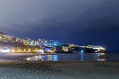 Praia Formosa beach in Funchal at night. Madeira island. Panoramic view at a stone beach Praia Formosa at night. Funchal, Portuguese island of Madeira stock images