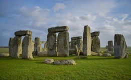 Panoramic view of Stonehenge landscape, prehistoric stone monument. Panoramic view of Stonehenge landscape with a blue cloudy sky, England. Ancient prehistoric stock photo