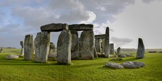 Panoramic view of Stonehenge landscape, prehistoric stone monument. Panoramic view of Stonehenge landscape with a blue cloudy sky, England. Ancient prehistoric royalty free stock photo
