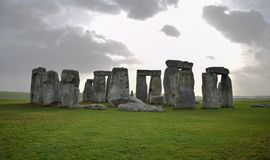 Panoramic view of Stonehenge landscape, prehistoric stone monument. Panoramic view of Stonehenge landscape with a cloudy sky, England. Ancient prehistoric stone stock photography