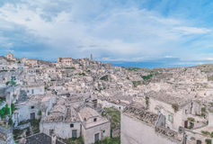 Panoramic view of stones (Sassi di Matera) and church of Matera under blue Royalty Free Stock Photography
