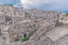 Panoramic view of stones (Sassi di Matera)  of Matera under blue sky. Matera in Italy Stock Photography