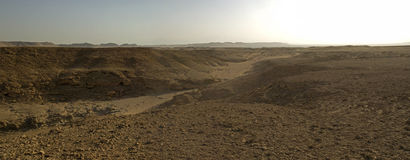 Panoramic view of a stony desert landscape. Panorama landscape scene of a stony desert Royalty Free Stock Image