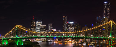 Panoramic view of Story bridge in yellow and green light at night time in Brisbane, Australia Royalty Free Stock Images