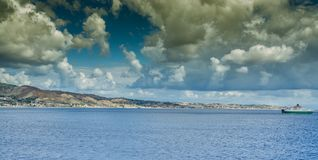 Panoramic view of the Strait of Messina which divides Sicily fro. M Italy. Useful for indicating travel by ship stock photo