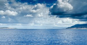 Panoramic view of the Strait of Messina which divides Sicily fro. M Italy. Useful for indicating travel by ship stock image