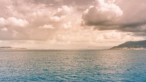 Panoramic view of the Strait of Messina which divides Sicily fro. M Italy. Useful for indicating travel by ship royalty free stock photos