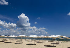 Panoramic view of straw umbrella on an empty beach Royalty Free Stock Photo