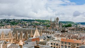 View of the streets and architecture in the historical city center of Rouen, France, with Saint-Ouen Abbey Church in the distance. Panoramic view of the streets stock photography