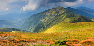 Panoramic view of summer landscape in mountains. Royalty Free Stock Photos