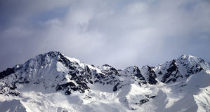 Panoramic view on sunlight winter mountains and sky with clouds Stock Photos