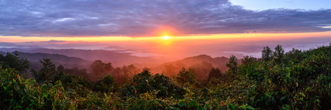 Panoramic view of sunrise with mist and mountain at Doi Pha Hom Pok, the second highest mountain in Thailand, Chiang Mai, Thailand Stock Photo